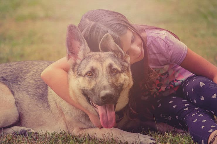 Girl and dog cuddle